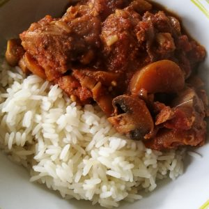 Slow Cooker Pork Casserole - A bowl of casserole and rice
