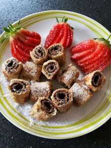 French Toast Doughnuts - little swirls of bread and chocolate spread, served with sliced strawberries