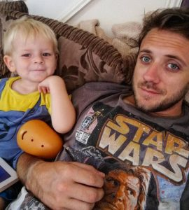 I wrote a post, forgot the title - Dad wearing a star wars t-shirt and a little boy with a yellow and blue top