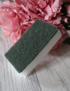 Unique Things About Me - A white sponge with a green scourer top in front of some pink flowers