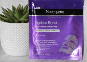 March 19 Glossybox - Purple Neutrogena Facemask leaning against a succulent in a white textured pot