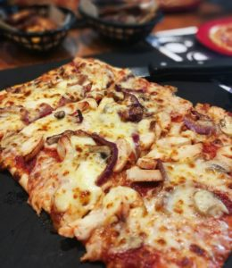 Dieting Myths - a rectangular meat feast pizza