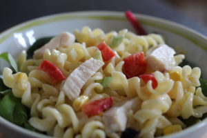 Chicken Mayonnaise Pasta Salad - a bowl with twirly pasta, chicken pieces and colourful veg