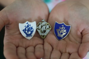 2 different Blue Peter badges being held in hands