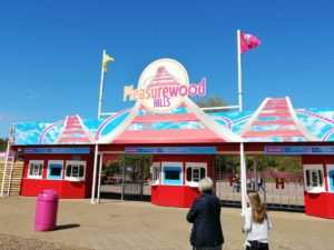 Frugal Family Days Out - Pleasurewood Hills sign on top of red and blue entrance gates