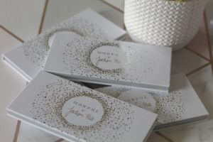 Favourite Beauty Products - 4 white palette cases with silver writing on top.
