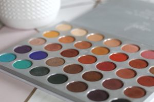 An open palette with 5 rows of circular pans full of different colours