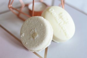 Lush Hair Care Bars - two creamy coloured bars leaning against each other