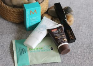 July 19 Glossybox - the contents of the box laying on a few rocks