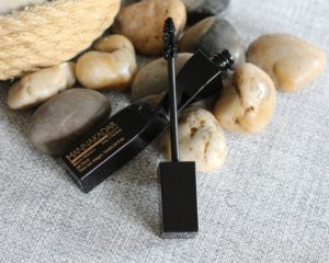 July 19' Glossybox - a black mascara with the wand resting on the bottle