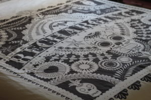 How to get a better night's sleep - Black and white bedcovers with tattoo style writing and sugar skulls