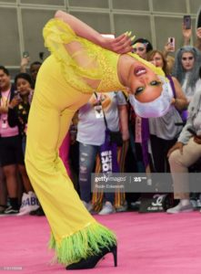 Joint Hypermobility Syndrome - Yvie Odly bent backwards looking at the camera on the pink carpet