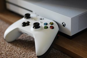 5 truths about living with a gamer - a white Xbox One controller sat in front of a white Xbox