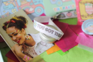 """The festival bracelet which is white with the words """"You got this"""" on it."""