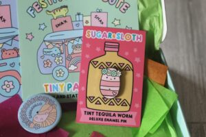 Sugar & Sloth Tiny Party Club enamel pin badge - A little tequila worn wearing a flower crown.