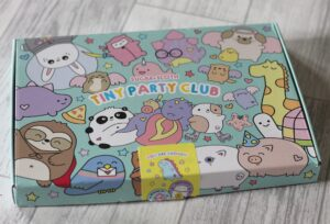 Sugar & Sloth Tiny Party Club box -A bright box covered in cute animal cartoons