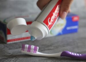 Fun ways of getting kids to look after their teeth - someone squeezing toothpaste onto a brush