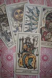 What is Wicca? Tarot cards layed out with Justice on top.
